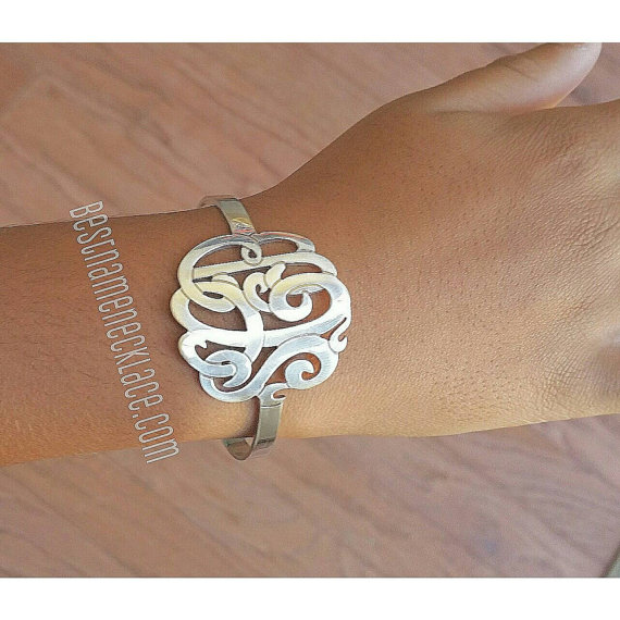 interlocking-monogram-bangle-cuff.jpg